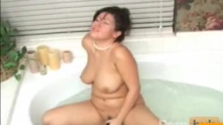 Asian MILF toys herself in the bath  big tits masturbation boobs tease dildo asian solo milf pussy bath wet water cocktease butsy toy
