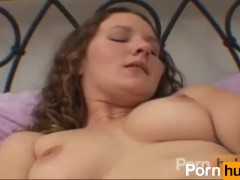 Curly brunette dildoes her tight pussy