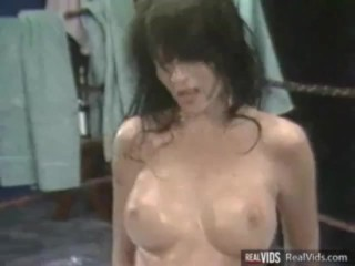 Oiled busty chick gets banged on ring