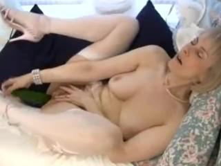 Horny granny cucumber pussy penetration