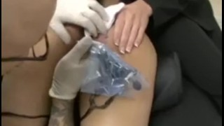 Amateur babe gets her asshole tattooed