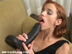 Horny little redhead fucking a brutal dildo