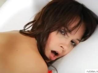 Petite beauty fucks her tiny cunt