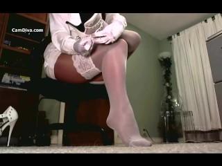 Shiny stockings over high gloss nylons leg tease