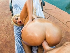 Big-booty blonde slut oils up her ass for some hardcore anal