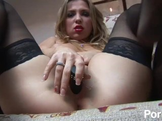 Sexy blonde in nylons pleasures her pussy