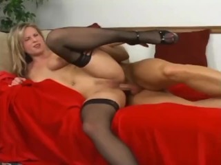Sexy blonde milf with nice tits fucking in black thigh high stockings