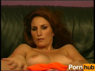 Euro babe plays with her pussy