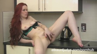 Naughty Milf Mastique cums on a kitchen counter  mommy mother cougar rubbing masterbation masturbating redhead wife mom masturbate solo