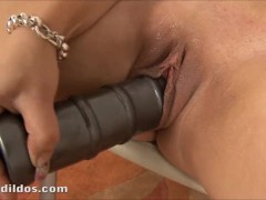 Busty babe masturbating with a big silver bullet rippled dildo in hd