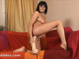 Brunette with a nice body has fun riding a big white brutal dildo in HD