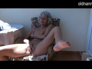 Old mature masturbating on the balcony