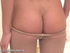 Naked brunette posing sexy in tan pantyhose