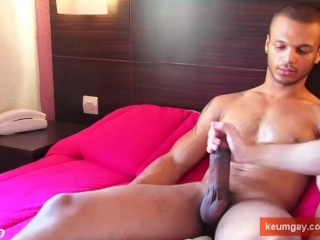 A very sexy mixed guy get wanked his very huge cock in spite of him !