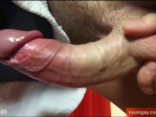 A sexy swimmer guy get wanked his huge cock by a guy !