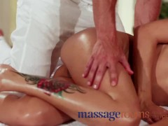 Massage Rooms Beautiful brunette oils up big cock before horny creampie