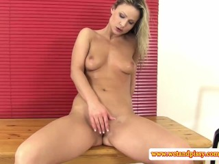 Goldenshower loving eurobabe plays with pee