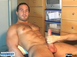 A straight sport guy gets wanked his huge cock by a guy in spite of him!