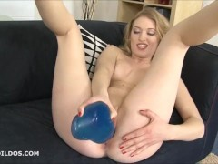Blonde babe fucking herself with a big brutal blue dildo