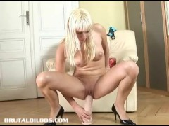 Tight European blonde filling her pussy with a brutal dildo