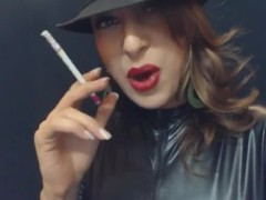 Smoking 120's in leather after putting on bright red lipstick AGENTSEXYHOT