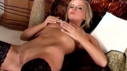 Busty blonde glamour babe in sexy thigh high stockings rubbing her pussy
