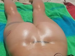 Nude Beach Voyeur - Oiled up Lydia shaking her tan booty