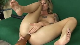 Tatted up Tricia swallowing a thick dildo with her ass