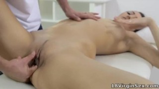Tight pussy Nika has her masseuse take her virginity