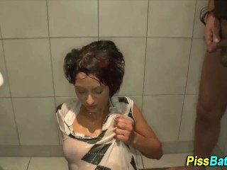 Piss whore showers in hot pee stream