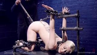 blonde suffers through metal bondage