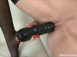 Blonde babe in black stockings fucking herself with a big black dildo in HD