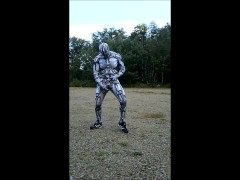 Spandex android jerking off inside spandex outdoors