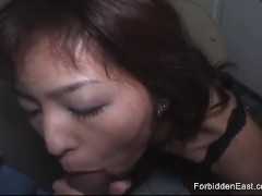 Oriental girl with great tis sucks cock deep in a toilet cubicle