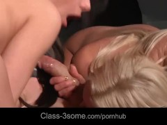 Two hardcore babes almost engulfing a male's horny manhood