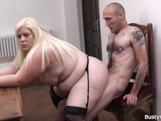 Plump blonde in stockings rides her boss