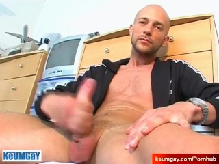 Stef, a gym club trainer gets serviced his big cock by me in spite of him !