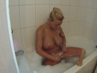 Dildoing myself in the bubble bath till orgasm while soaping up my tits
