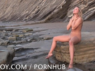 Whitney Conroy playing naked on the beach