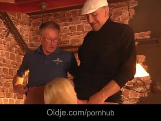 Turists old men threesome with bimbo american blonde in a pub
