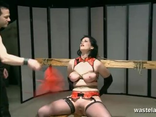 Slave in stockings has wax poured on her big tits as she sucks Masters cock