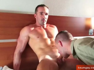Hotel's client gets sucked his cock by a room service guy in spite of him.