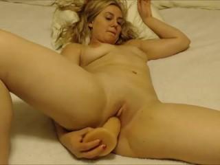 Krisi Foxx uses large cum squirting dildo