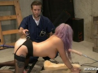 Sex slave fucked between two fuck machines by Master on the dungeon floor