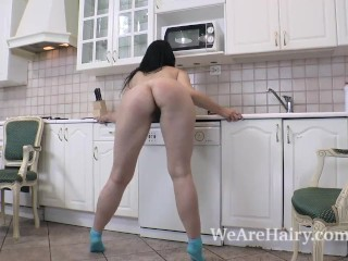 Love Morris does an erotic striptease in kitchen