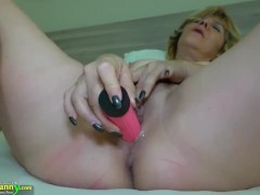 Horny sexy mature in bed masturbates with dildo