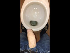 Taking a dirty piss in a public toilet