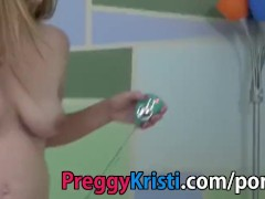 Pregnant girl with vibrator in tight pussy