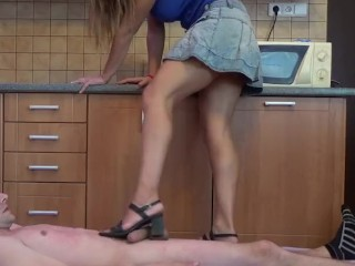 Sexy girl in sandals trampling in the kitchen