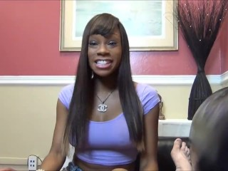 Ebony give footjob to white guy